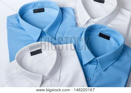 Set of blue and white mans shirt closeup