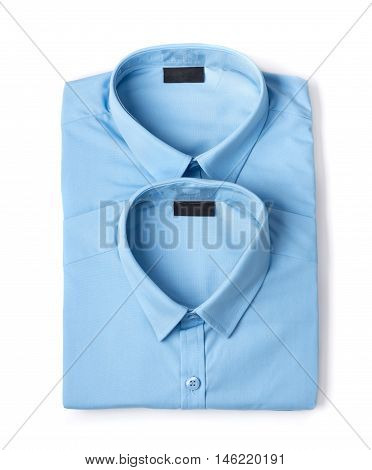 Two folded blue new men's shirts close-up isolated on white background