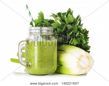 Green smoothies in a glass jar a cocktail stick stems and leaves of celery isolated on white background healthy eating concept