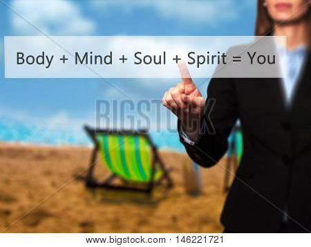 Body + Mind + Soul + Spirit = You - Isolated Female Hand Touching Or Pointing To Button