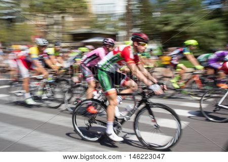 VALENCIA, SPAIN - SEPTEMBER 1, 2016: Start of the Volta de Valencia which is a four day bicycle race covering 318 miles throughout the Valencia Province. Intentional motion blur in camera.