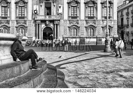 Catania, Sicily Elderly Lonely Sitting In The Square, Italy
