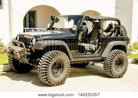 SKYROS island GREECE - AUGUST 03 2016: The Jeep Wrangler is a 4wheels drive off-road and sport utility vehicle (SUV) manufactured by American automaker Chrysler.