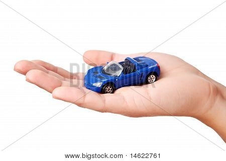 Hand holding small blue car