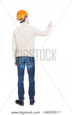 Back view of  pointing young men in helmet. Young guy  gesture. Rear view people collection.  backside view of person.  Isolated over white background. Engineer points a finger somewhere