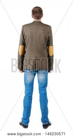 Back view of business man in jacket .  looking ahead of yourself. Isolated over white.  Standing young guy in jeans and suit jacket. Rear view people collection.  backside view of person.
