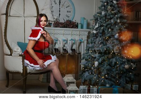Beautiful Girl With Magnificent Forms Of Dress And White Stockings Snow Maiden, Sitting In A Chair N