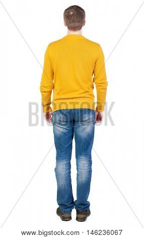Back view of man in jeans. Standing young guy. Rear view people collection.  backside view of person.  Isolated over white background. the guy in the yellow jersey is exactly with her hands