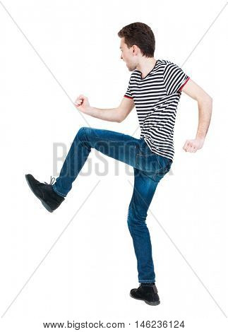 back view of skinny guy funny fights waving his arms and legs. Isolated over white background. Rear view people collection.  backside view of person. Funny guy clumsily boxing. The guy in the striped