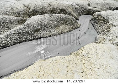 Landscape with mud volcanoes also known as mud domes erupting in summer