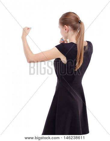 skinny woman funny fights waving his arms and legs. Blonde in a short black dress ready to fight.