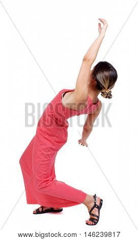 Balancing young woman. or dodge falling woman. slender woman in a long red dress falls on his back.