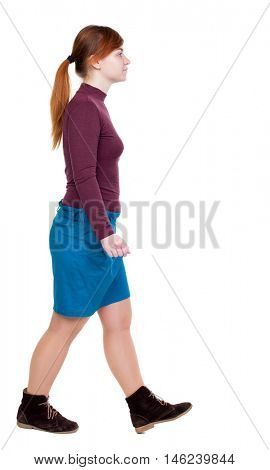 back view of walking woman. Girl with red hair tied in a pigtail goes to the side.