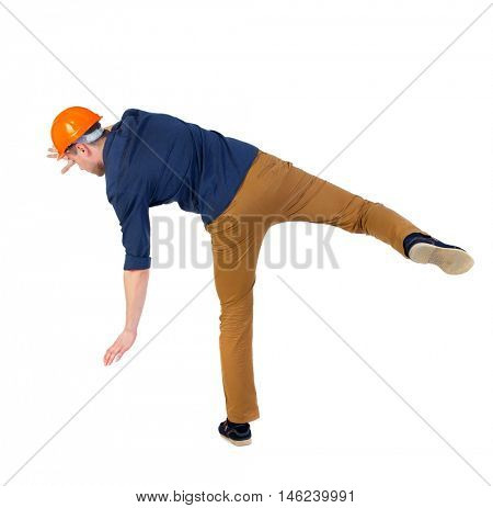 Balancing young man. or dodge the falling man. man in a blue shirt and a helmet falls trying to keep on the right foot.