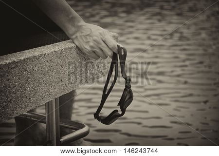 Men sit and wait hoping the water. Handle swimming goggles
