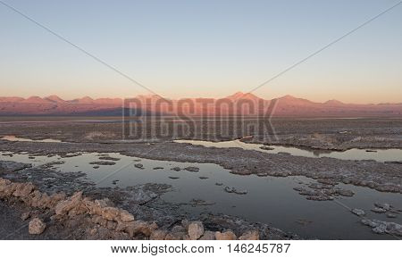 Sunset in Atacama Salar, Chile / Salt lake and mountains at Atacama Salar, Chile