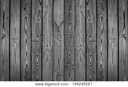 Old wooden fence. dark wood palisade background. planks texture