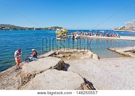 People Fish And Stand In Line For A Boat Ride