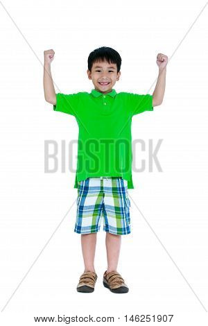 Strong and confident child. Full body of happy asian child in leather shoes smiling and raising his hands up. Stylish boy having fun. Isolated on white background. Studio shot. Positive human emotion.