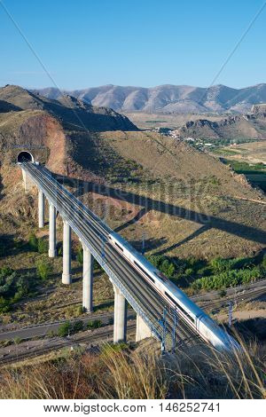 view of a high-speed train crossing a viaduct in Purroy, Zaragoza, Aragon, Spain.  Madrid Barcelona.