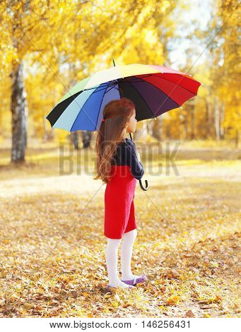 Little Girl Child With Colorful Umbrella Dreaming In Sunny Autumn Day Looking View Profile