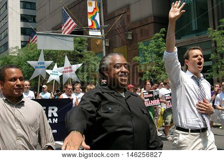 New York City - June 25 2005: The Reverend Al Sharpton marching with openly gay mayoral candidate Brian Ellner (right) at the 2005 Gay Pride Parade on Fifth Avenue