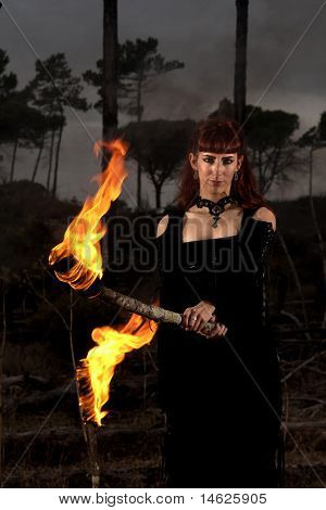 Dark Woman With Torch