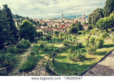 View from Giardino delle Rose to the city of Florence. Tuscany Italy. Travelling scene. Beautiful place. Greenery and town. Retro photo filter. Cradle of the renaissance. Cultural heritage.