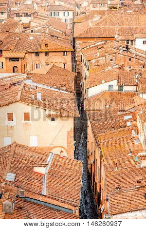 Aerial cityscape view on the narrow street in the old town of Lucca in Italy