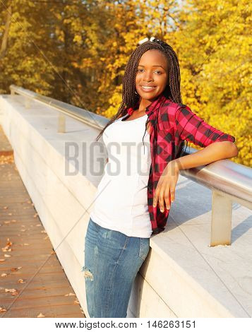 Pretty Smiling African Woman Wearing A Red Checkered Shirt In Sunny Evening