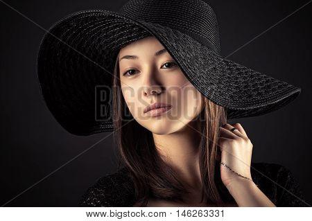 beautiful Mixed Race Korean Russian girl with black hat