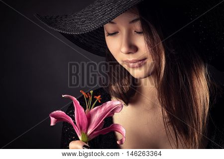 Mixed Race Korean Russian teenager girl with lily flower