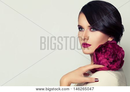 Elegant Woman Fashion Model with Burgundy Lips Makeup and Peony Flower