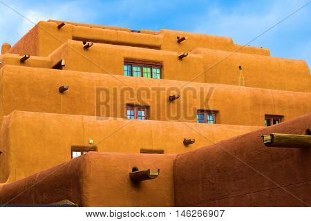Southwestern adobe style building with a mixture of modern and historical architectural design taken in Santa Fe, NM