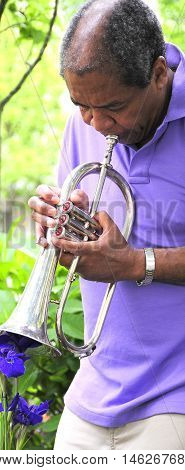 African american male with his flugelhorn outside.