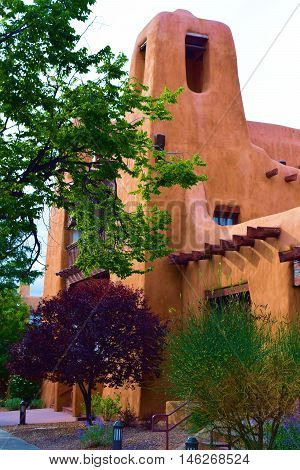 Building with a mixture of historic and modern adobe architecture and design taken in Santa Fe, NM
