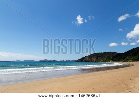 Russell, New Zealand - February 18, 2015: A sandy beach called Long beach close at Oneroa Bay