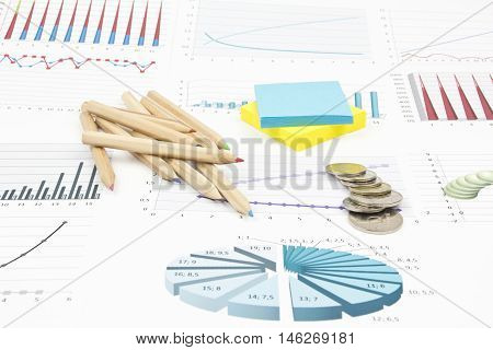 Business still-life of pencil, charts, coins, stickers