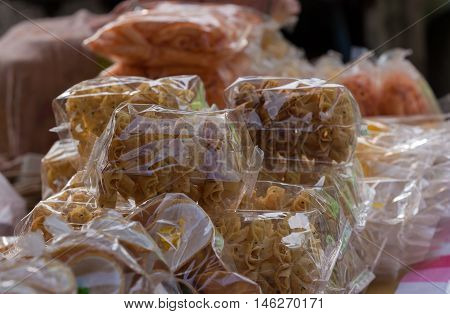 Various thai snack in plastick bag on local market in temple festival.