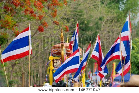 Thai flag parade in wax festival in Thailand.