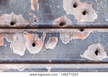 Rusty And Scratched Metal Panel Background With Bullet Holes