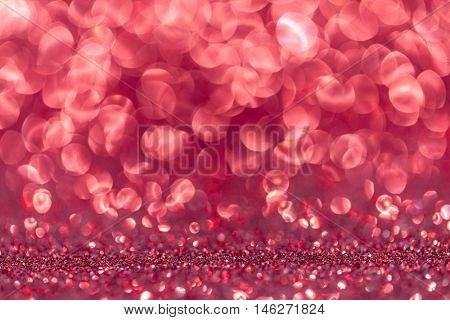 Abstract background with red shiny glitter bokeh lights
