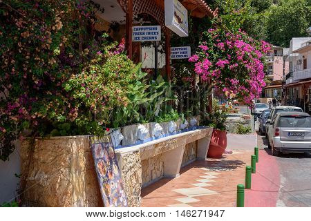 SPILI, CRETE, GREECE - JULY 2016: Street of Spili town with souvenir shops and taverns on Crete island.