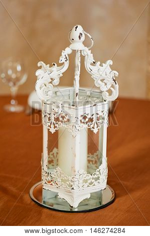 White wrought-iron candlestick. The decor of the room. Tenderness