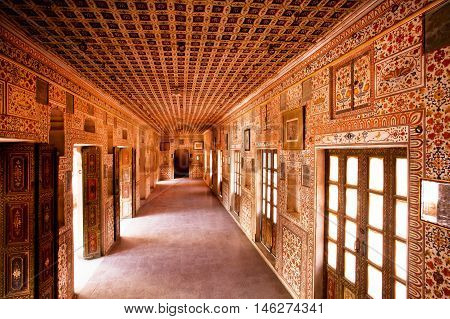 BIKANER, INDIA - MAR 4, 2015: Inside the royal palace with many fresco in 16th century Junagarh Fort on March 4 2015. The 5.28 hectares large Junagarh fort precinct is studded with palaces temples and pavilions