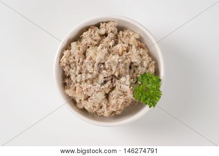 bowl of fish spread on white background