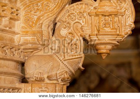 Pillars with ancient carvings of stone sanctuary in 12th century Jain temples situated in the Jaisalmer Fort, Rajasthan, India.