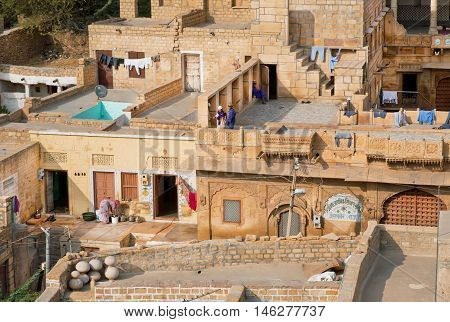 JAISALMER, INDIA - MAR 1, 2015: Grunge stone houses in poor area of historical indian town on March 1, 2015. Jaisalmer lies in the heart of the Thar Desert and has a population of about 78000.