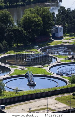 Sewage Water Treatment Plant With River In Background Aerial View