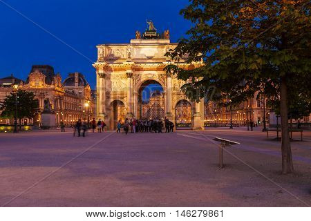 Paris, France - April 6, 2011: People Walking In Front Of Arc De Triomphe And Louvre Palace